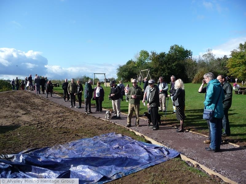 Cage Detaching Hook Memorial Sculpture - visitors assemble